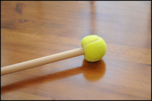 Pool stick with tennis ball on the end
